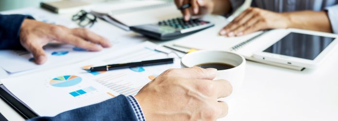 business man financial inspector and secretary making report, calculating or checking balance. Internal Revenue Service inspector checking document. Audit concept